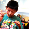 "Escuela Bilingüe Pioneer third-grader Luis Franco paints his maraca during a celebration for César Chávez day on Friday, April 1, at Escuela Bilingüe Pioneer Elementary school in Lafayette. For more photos and a video of the march go to  <a href=""http://www.dailycamera.com"">http://www.dailycamera.com</a><br /> Jeremy Papasso/ Camera"