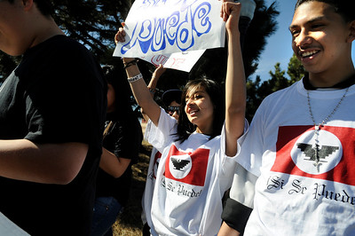 Centaurus High School freshman Zujey Gordillo, left, and Federico Chavez, right, show their support during the César Chávez Day march on Friday, April 1, at Escuela Bilingüe Pioneer Elementary school in Lafayette. For more photos and a video of the march go to www.dailycamera.com Jeremy Papasso/ Camera