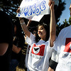 "Centaurus High School freshman Zujey Gordillo, left, and Federico Chavez, right, show their support during the César Chávez Day march on Friday, April 1, at Escuela Bilingüe Pioneer Elementary school in Lafayette. For more photos and a video of the march go to  <a href=""http://www.dailycamera.com"">http://www.dailycamera.com</a><br /> Jeremy Papasso/ Camera"