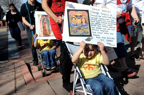 """Nizhoni Encina-Serrano, 3, front, holds a sign regarding social change during the César Chávez day march on Friday, April 1, at Escuela Bilingüe Pioneer Elementary school in Lafayette. For more photos and a video of the march go to  <a href=""""http://www.dailycamera.com"""">http://www.dailycamera.com</a><br /> Jeremy Papasso/ Camera"""
