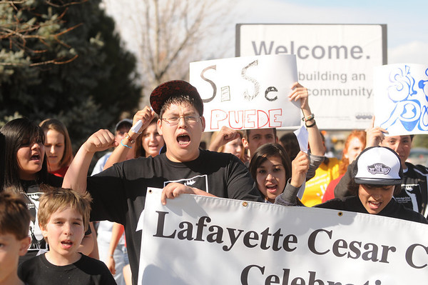"""Jorge Negrete, raises his hand and cheers as he marches for Cesar Chavez day on Friday, April 1, at Pioneer Bilingual Elementary School in Lafayette. For more photos and a video of the march go to  <a href=""""http://www.dailycamera.com...Jeremy"""">http://www.dailycamera.com...Jeremy</a> Papasso/ Camera"""