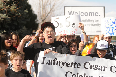 Jorge Negrete, raises his hand and cheers as he marches for Cesar Chavez day on Friday, April 1, at Pioneer Bilingual Elementary School in Lafayette. For more photos and a video of the march go to www.dailycamera.com...Jeremy Papasso/ Camera