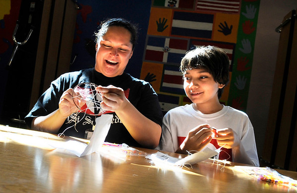 "Louisville Middle School student Ben Salazar and his mother Genesa Gonzalez, work together to make a dream catcher during a celebration for César Chávez day on Friday, April 1, at Escuela Bilingüe Pioneer Elementary school in Lafayette. For more photos and a video of the march go to  <a href=""http://www.dailycamera.com"">http://www.dailycamera.com</a><br /> Jeremy Papasso/ Camera"