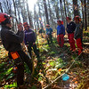 "KRISTOPHER RADDER — BRATTLEBORO REFORMER<br /> Kyle Brennan, from Northeast Woodland Training, tells a group of students from the Windham Regional Career Center's Forestry Class how to properly cut a ""spring"" tree without hurting someone at the Brattleboro Watershed Forest on Wednesday, Nov. 6, 2019."