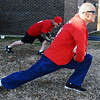 Patrick Nine of Carthage stretches Wednesday morning , Jan. 1, 2014, prior to the Chilly Challenge 5K run at the Joplin Family Y South.<br /> Globe | T. Rob Brown