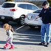 """The Chain of Command"" or ""Leash Law""<br /> Rick Boyd of Oronogo holds tight to a child leash as his 2-year-old granddaughter Peyton Adamson of Webb City pulls against him as she walks around the Joplin Family Y South parking lot Wednesday morning, Jan. 1, 2014. The family was there for the Chilly Challenge 5K run.<br /> Globe 