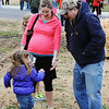 Ruth Taylor (center) and her father Bobby Thomas ready for the approach of Ruth's 3-year-old daughter Kameron Taylor follwing the Chilly Challenge 5K run Wednesday morning , Jan. 1, 2014, at the Joplin Family Y South. Ruth Taylor has an estimated time less than 30 days left on her pregnancy but was still able to run the 5K run.<br /> Globe | T. Rob Brown