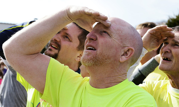 Robert Berry (center) of Miami, Okla., and with the Miami Ice Racing team, looks up at the results board follwing the Chilly Challenge 5K run Wednesday morning , Jan. 1, 2014, at the Joplin Family Y South.<br /> Globe | T. Rob Brown