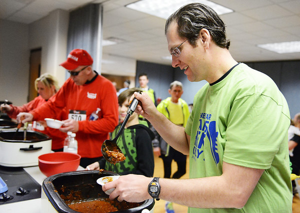 Lance Borup of Joplin grabs a bowl of chili follwing the Chilly Challenge 5K run Wednesday morning , Jan. 1, 2014, at the Joplin Family Y South.<br /> Globe | T. Rob Brown