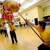 "Dave Spielman, right, uses the teaser to entice the dragon.<br /> Students of the Shaolin Hung Mei Kung Fu Academy in Boulder  assembled a 75-foot dragon in advance of the Colorado Dragon Boat Festival at the end of July.<br /> For more photos and a video of the assembly, go to  <a href=""http://www.dailycamera.com"">http://www.dailycamera.com</a>.<br /> Cliff Grassmick / July 7, 2012"