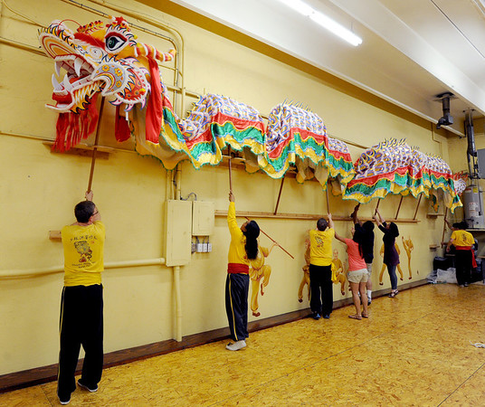 """Students of the Shaolin Hung Mei Kung Fu Academy in Boulder  assembled a 75-foot dragon in advance of the Colorado Dragon Boat Festival at the end of July.<br /> For more photos and a video of the assembly, go to  <a href=""""http://www.dailycamera.com"""">http://www.dailycamera.com</a>.<br /> Cliff Grassmick / July 7, 2012"""