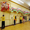 "Students of the Shaolin Hung Mei Kung Fu Academy in Boulder  assembled a 75-foot dragon in advance of the Colorado Dragon Boat Festival at the end of July.<br /> For more photos and a video of the assembly, go to  <a href=""http://www.dailycamera.com"">http://www.dailycamera.com</a>.<br /> Cliff Grassmick / July 7, 2012"