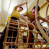 "Oliver DeWolfe, left, and Brandon Rachal, assemble the skeleton of the new dragon.<br /> Students of the Shaolin Hung Mei Kung Fu Academy in Boulder  assembled a 75-foot dragon in advance of the Colorado Dragon Boat Festival at the end of July.<br /> For more photos and a video of the assembly, go to  <a href=""http://www.dailycamera.com"">http://www.dailycamera.com</a>.<br /> Cliff Grassmick / July 7, 2012"