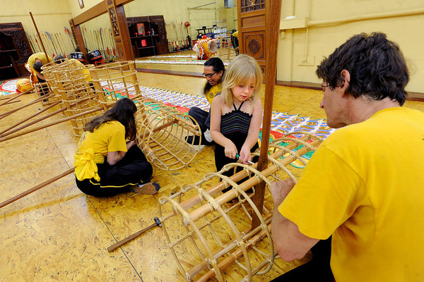 "Daelie Paulsen, 7, and her father, Dave Spielman, help the group  assemble the skeleton of the new dragon.<br /> Students of the Shaolin Hung Mei Kung Fu Academy in Boulder  assembled a 75-foot dragon in advance of the Colorado Dragon Boat Festival at the end of July.<br /> For more photos and a video of the assembly, go to  <a href=""http://www.dailycamera.com"">http://www.dailycamera.com</a>.<br /> Cliff Grassmick / July 7, 2012"