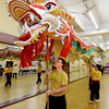 "Brandon Rachal, left, and Valiant Villanueva, were among 9 people needed to lift the new dragon.<br /> Students of the Shaolin Hung Mei Kung Fu Academy in Boulder  assembled a 75-foot dragon in advance of the Colorado Dragon Boat Festival at the end of July.<br /> For more photos and a video of the assembly, go to  <a href=""http://www.dailycamera.com"">http://www.dailycamera.com</a>.<br /> Cliff Grassmick / July 7, 2012"