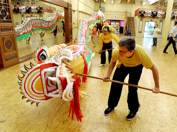 "Brandon Rachal, right, and Valiant Villanueva, were among 9 people needed to lift the new dragon.<br /> Students of the Shaolin Hung Mei Kung Fu Academy in Boulder  assembled a 75-foot dragon in advance of the Colorado Dragon Boat Festival at the end of July.<br /> For more photos and a video of the assembly, go to  <a href=""http://www.dailycamera.com"">http://www.dailycamera.com</a>.<br /> Cliff Grassmick / July 7, 2012"