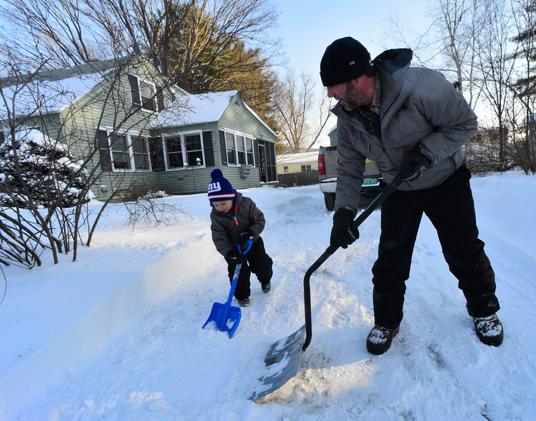 KRISTOPHER RADDER - BRATTLEBORO REFORMER<br /> Carter Christmas, 3, helps his father Seth with shoveling the snow from the driveway of 32 Marlboro Ave., in Brattleboro, Vt., on Friday, Jan. 5, 2018.