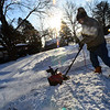 KRISTOPHER RADDER - BRATTLEBORO REFORMER<br /> Ben Coplan, of 56 Marlboro Ave., in Brattleboro, Vt., uses an electric snowblower to clear the snow from his driveway on Friday, Jan. 5, 2018.