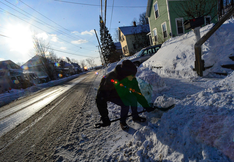 KRISTOPHER RADDER - BRATTLEBORO REFORMER<br /> Chris Stone, of 411 Main Street, in Brattleboro, Vt., removes the snow from the mouth of his walkway while cleaning up from Winter Storm Grayson on Friday, Jan. 5, 2018.