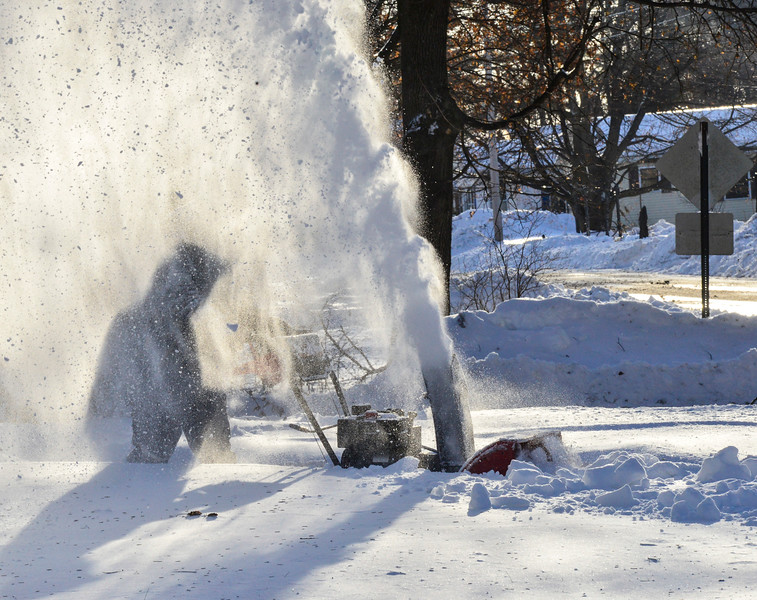 KRISTOPHER RADDER - BRATTLEBORO REFORMER<br /> Snow flies around Bill DeCosmo, of     Brattleboro, as he uses a snowblower to cut a path through the snow on Friday, Jan. 5, 2018.