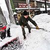 KRISTOPHER RADDER — BRATTLEBORO REFORMER<br /> Ananda Forest clears out a snow mound near the Hooker-Dunham Theater in Brattleboro on Monday, Dec. 2, 2019.