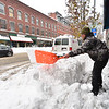 KRISTOPHER RADDER — BRATTLEBORO REFORMER<br /> Tom Tetreault shovels the sidewalk in front of Amy's Bakery Arts Cafe in Brattleboro on Monday, Dec. 2, 2019.