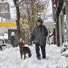 KRISTOPHER RADDER — BRATTLEBORO REFORMER<br /> Anne Cummingham walks her dog, Gracie, through the snow on Main Street in Brattleboro on Monday, Dec. 2, 2019.