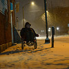 KRISTOPHER RADDER — BRATTLEBORO REFORMER<br /> Stephen Willard pushes his wheelchair through the snow toward his apartment in Keene, N.H., as the snow starts to fall on Sunday, Dec. 1, 2019.
