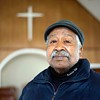 """BEN GARVER - THE BERKSHIRE EAGLE<br /> Wray Gunn of the Clinton Church Restoration project visits the former Clinton AME Zion Church in Great Barrington. Gunn said """"We are close to raching the fundraising goal to buy the church building, we need a little more for closing costs."""" The project will preserve the church as a community center."""