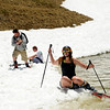 "Carolyn Brent, of Boulder, struggles to get out of the freezing water after falling while attempting to skim across a pond with her snow skis on Friday, July 1, at Arapahoe Basin Ski Resort in Summit County. For a video of the ski day go to  <a href=""http://www.dailycamera.com"">http://www.dailycamera.com</a><br /> Jeremy Papasso/ Camera"
