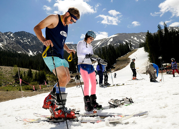"Sam Hubley, left, and Christie Slater, both of Boulder, strap on their skis and snowboard ready to hit the slopes on Friday, July 1, at Arapahoe Basin Ski Resort in Summit County. For a video of the summer ski day go to  <a href=""http://www.dailycamera.com"">http://www.dailycamera.com</a><br /> Jeremy Papasso/ Camera"