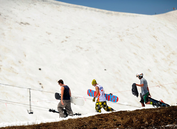 """Snowboarders enjoy the last few days of the ski season on Friday, July 1, at Arapahoe Basin Ski Resort in Summit County. For a video of the ski day go to  <a href=""""http://www.dailycamera.com"""">http://www.dailycamera.com</a><br /> Jeremy Papasso/ Camera"""