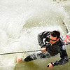 "Clayton Shaffer, of Westminster, goes down hard while attempting to skim across a pond on his snow skis on Friday, July 1, at Arapahoe Basin Ski Resort in Summit County.  For a video of the summer ski day go to  <a href=""http://www.dailycamera.com"">http://www.dailycamera.com</a><br /> Jeremy Papasso/ Camera"