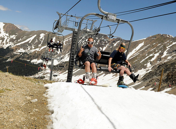 Jeff Bennett, of Denver, left, and his friend Eli Parks, also of Denver, reach the top of the mountain on the ski lift on Friday, July 1, at Arapahoe Basin Ski Resort in Summit County.<br /> Jeremy Papasso/ Camera
