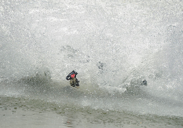 "Goggles and hat go flying after someone yard-sailed while skimming the pond on Friday, July 1, at Arapahoe Basin Ski Resort in Summit County. For a video of the ski day go to  <a href=""http://www.dailycamera.com"">http://www.dailycamera.com</a><br /> Jeremy Papasso/ Camera"