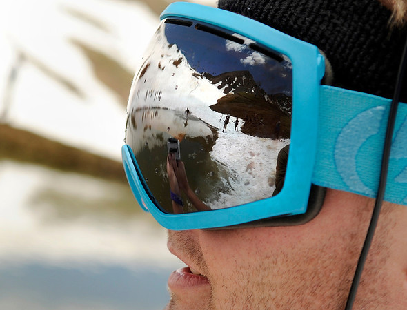 """Tanner Nobles, of Avon, records footage while his friend attempts to skim across the pond on his snowboard on Friday, July 1, at Arapahoe Basin Ski Resort in Summit County. For a video of the ski day go to  <a href=""""http://www.dailycamera.com"""">http://www.dailycamera.com</a><br /> Jeremy Papasso/ Camera"""