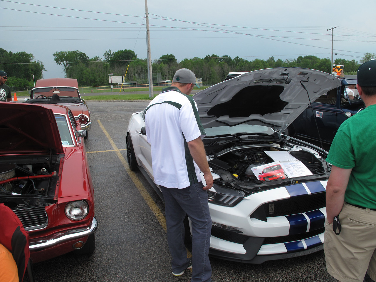 BOB FINNAN / GAZETTE Several onlookers admire the 2016 Ford Shelby GT 350 Sunday at the Cloverleaf High School bowling team car show.