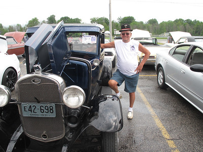 BOB FINNAN / GAZETTE Spud Brinker, of Creston, stands next to his 1931 Ford Model A at the Cloverleaf High School bowling team car show Sunday.