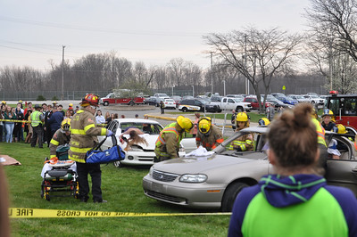 ASHLEY FOX/GAZETTE A Cloverleaf High School student watches emergency crews prepare to cut victims out of a car during a mock car crash on Tuesday morning.