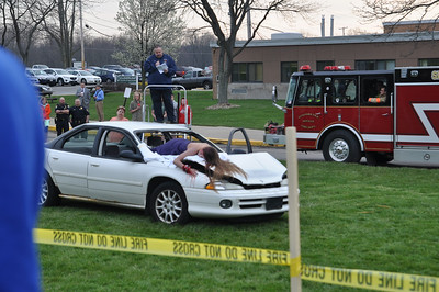 ASHLEY FOX/GAZETTE Kayla Wilson, a student actor in the Cloverleaf Mock Crash on Tuesday, played the part of a passenger who was not belted in the car. Her character was pronounced dead at the scene.
