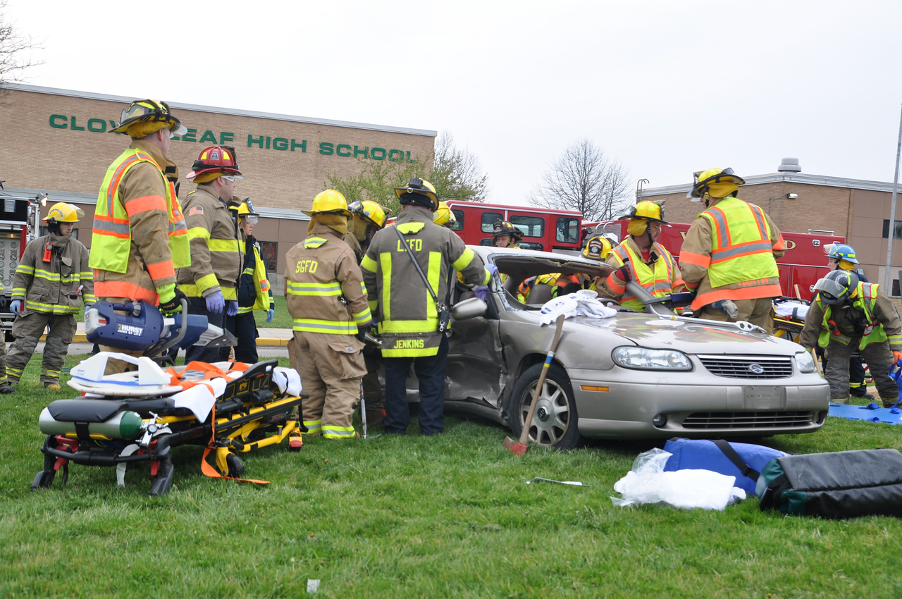ASHLEY FOX / GAZETTE Students are cut out of a Chevrolet Malibu as part of a Mock Car Crash on Tuesday Morning. The event is held every other year to show the dangers of driving under the influence.