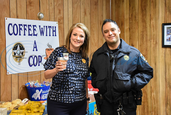 Jacksonville Chamber Chairwoman Patty Rivers (left) and Jacksonville Officer James Lozano smile for a photo at Coffee with a Cop on Thursday, February 20. The first one of the year was hosted by the Jacksonville Chamber of Commerce and welcomed new Police Chief Joe Williams.