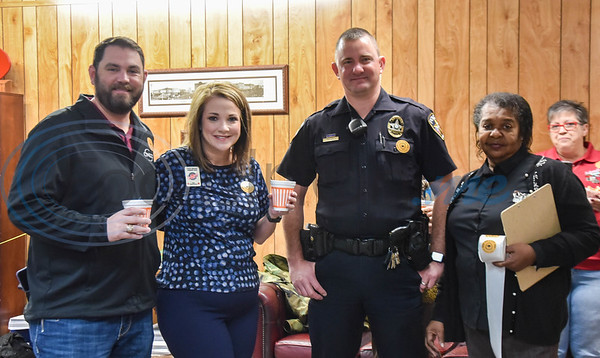(From left) Tom Trimble, Patty Rivers, Office Jeff Dockter and Fannie Franklin smile for a photo while attending Coffee with a Cop on Thursday, February 20. The event was hosted by the Jacksonville Chamber of Commerce.
