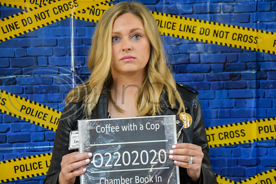 Lauren Carter, Director of Business Development at the Legacy at Jacksonville, looks somber while getting 'booked in' at a Coffee with a Cop event hosted by the Jacksonville Chamber of Commerce. The event, which happens several times throughout the year, was the first one of 2020.