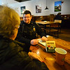 KRISTOPHER RADDER — BRATTLEBORO REFORMER<br /> Vickie Case talks with Ryan Washburn, Brattleboro police officer,  during a Coffee with a Cop event at The Works, in Brattleboro, on Wednesday, Dec. 18, 2019.