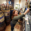 "Curator Julie Schumaker installs beer taps on Monday, Feb. 25, at the beer history exhibit at the Boulder History Museum in Boulder. For a video about the exhibit go to  <a href=""http://www.dailycamera.com"">http://www.dailycamera.com</a><br /> Jeremy Papasso/ Camera"