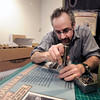 "Principal exhibit designer Seth Frankel cuts out a hole for a interactive button on a sign while assembling the beer history exhibit on Monday, Feb. 26, at the Boulder History Museum in Boulder. For a video about the exhibit go to  <a href=""http://www.dailycamera.com"">http://www.dailycamera.com</a><br /> Jeremy Papasso/ Camera"