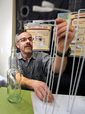 """Principal exhibit designer Seth Frankel sets up a beer station on Monday, Feb. 25, at the beer history exhibit at the Boulder History Museum in Boulder. For a video about the exhibit go to  <a href=""""http://www.dailycamera.com"""">http://www.dailycamera.com</a><br /> Jeremy Papasso/ Camera"""