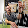 "Principal exhibit designer Seth Frankel sets up a beer station on Monday, Feb. 25, at the beer history exhibit at the Boulder History Museum in Boulder. For a video about the exhibit go to  <a href=""http://www.dailycamera.com"">http://www.dailycamera.com</a><br /> Jeremy Papasso/ Camera"