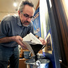 "Principal exhibit designer Seth Frankel pours black malt into a bucket while setting up the beer history exhibit on Monday, Feb. 26, at the  Boulder History Museum in Boulder. For a video about the exhibit go to  <a href=""http://www.dailycamera.com"">http://www.dailycamera.com</a><br /> Jeremy Papasso/ Camera"